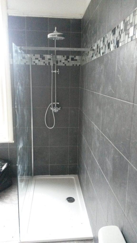 Tiled shower area, bathroom renovation